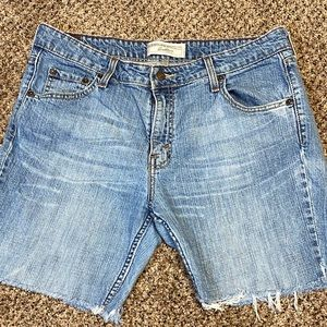 Levi Strauss distressed cutoffs broken in